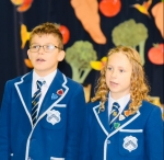 Head Boy and Head Girl at Westville House School open the schools Harvest Festival Assembly